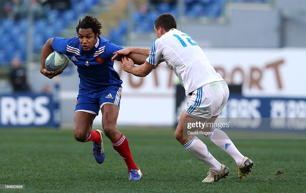 Benjamin Fall of France is held by Alberto Sgarbi during the RBS Six Nations match between Italy and France at Stadio Olimpico on February 3, 2013 in Rome, Italy.