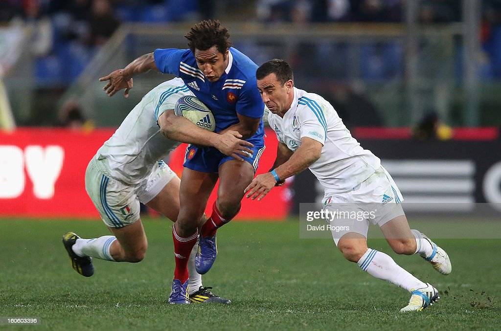 Benjamin Fall of France is tackled by Sergio Parisse (L) and Luciano Orquera between Italy and France at Stadio Olimpico on February 3, 2013 in Rome, Italy.