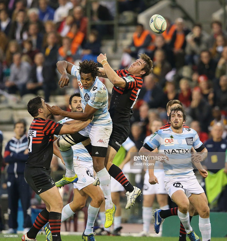 <a gi-track='captionPersonalityLinkClicked' href=/galleries/search?phrase=Benjamin+Fall&family=editorial&specificpeople=5405287 ng-click='$event.stopPropagation()'>Benjamin Fall</a> of Racing Metro is challenged by <a gi-track='captionPersonalityLinkClicked' href=/galleries/search?phrase=Chris+Wyles&family=editorial&specificpeople=764213 ng-click='$event.stopPropagation()'>Chris Wyles</a> (R) and <a gi-track='captionPersonalityLinkClicked' href=/galleries/search?phrase=Brad+Barritt&family=editorial&specificpeople=4542508 ng-click='$event.stopPropagation()'>Brad Barritt</a> during the Heineken Cup match between Saracens and Racing Metro at King Baudouin Stadium on October 20, 2012 in Brussels, Belgium.