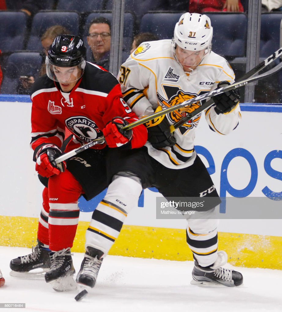 Benjamin Gagne #9 of the Quebec Remparts and Ivan Korosenkov #37 of the Victoriaville Tigres battle for the puck during the second period of their QMJHL hockey game at the Centre Videotron on October 12, 2017 in Quebec City, Quebec, Canada.