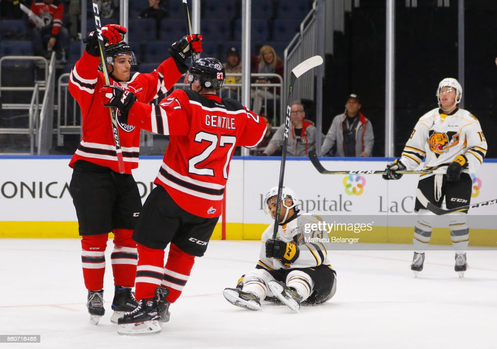 Benjamin Gagne #9 of the Quebec Remparts celebrates his goal with his teammate Derek Gentile #27 against the Victoriaville Tigres during the third period of their QMJHL hockey game at the Centre Videotron on October 12, 2017 in Quebec City, Quebec, Canada.