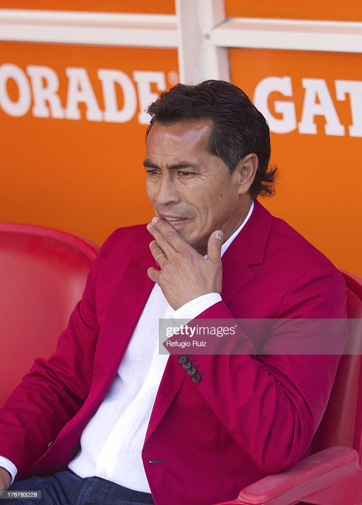 Benjamin Galindo, coach of Chivas looks on during a match between Chivas and Puebla as part of the Torneo Apertura Liga MX at the Omnilife Stadium on August 18, 2013 in Guadalajara, Mexico.