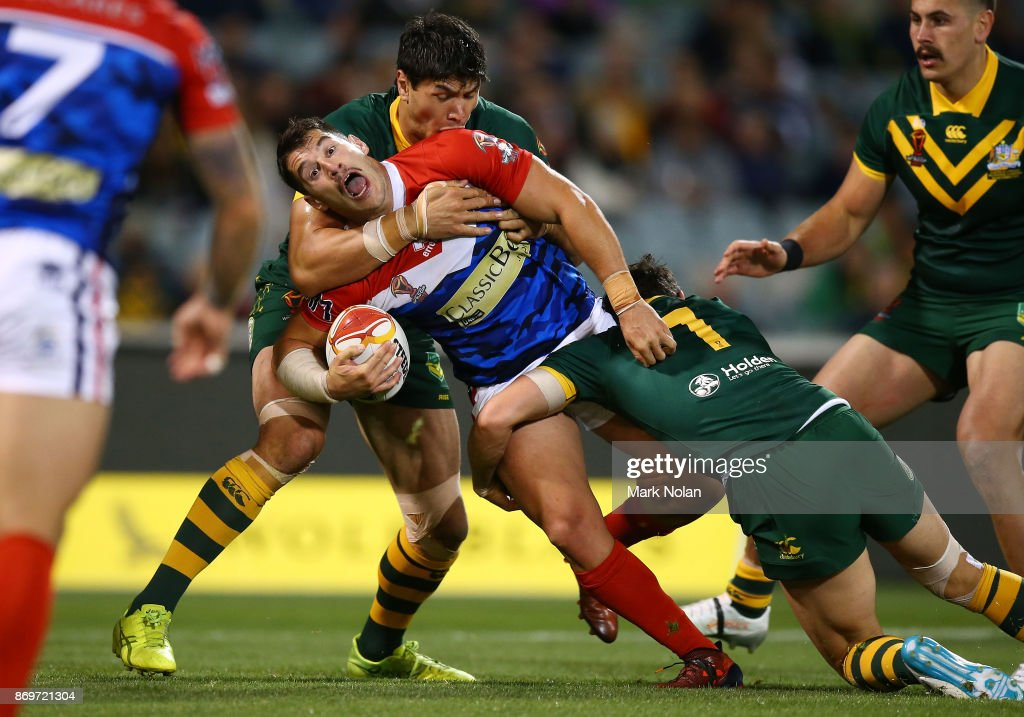 Benjamin Garcia of France is tackled during the 2017 Rugby League World Cup match between Australian Kangaroos and France at Canberra Stadium on November 3, 2017 in Canberra, Australia.