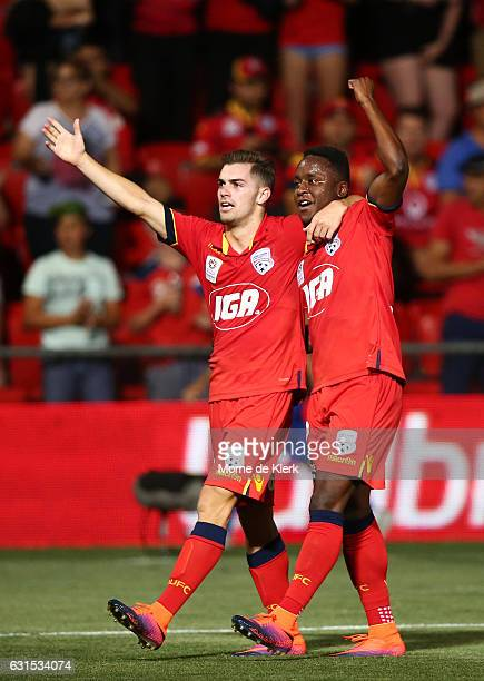 Benjamin Garuccio and Mark Ochieng of Adelaide United celebrate after the round 15 ALeague match between Adelaide United and Melbourne City FC at...