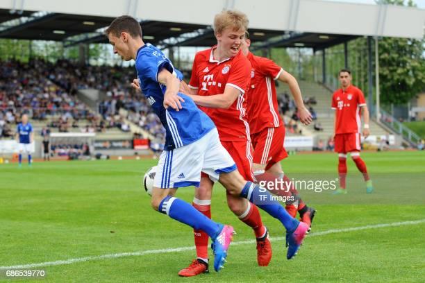 Benjamin Goller of Schalke and Felix Goetze of Munich battle for the ball during the U19 German Championship Semi Final second leg match between FC...