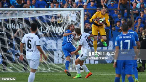 Benjamin Gommert of Meppen saves a ball during the Relegation Regionalliga Play Off second leg match at Hensch Arena on May 31 2017 in Meppen Germany