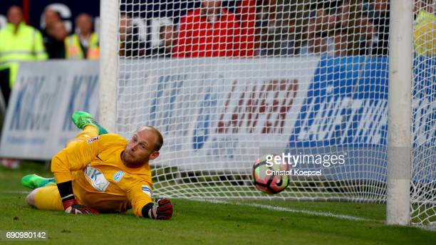 Benjamin Gommert of Meppen saves the decision shoot of Marcel Segelt of Mannheim during the penalty shootout during the Relegation Regionalliga Play...