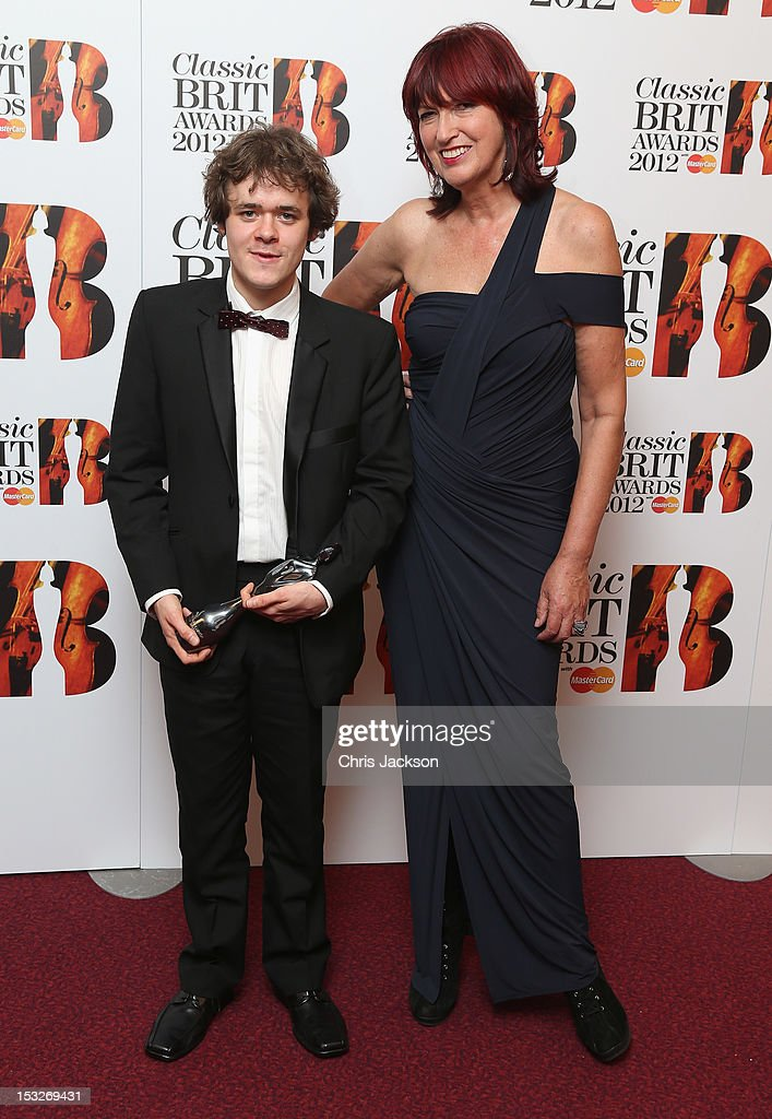 Benjamin Grosvenor holds up the 'Critic's Choice Award' with Janet Street-Porter as he attends the Classic BRIT Awards at the Royal Albert Hall on October 2, 2012 in London, England.