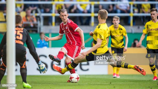 Benjamin Hadzic of Munich and Amos Pieper of Dortmund fight for the ball during the U19 German Championship Final between Borussia Dortmund and FC...