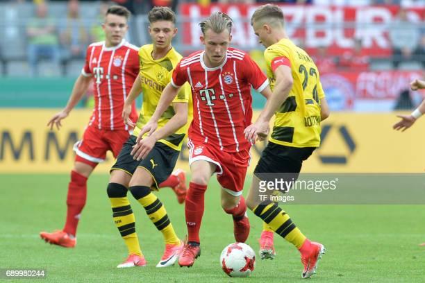Benjamin Hadzic of Munich and Dzenis Burnic of Dortmund battle for the ball during the U19 German Championship Final match between U19 Borussia...