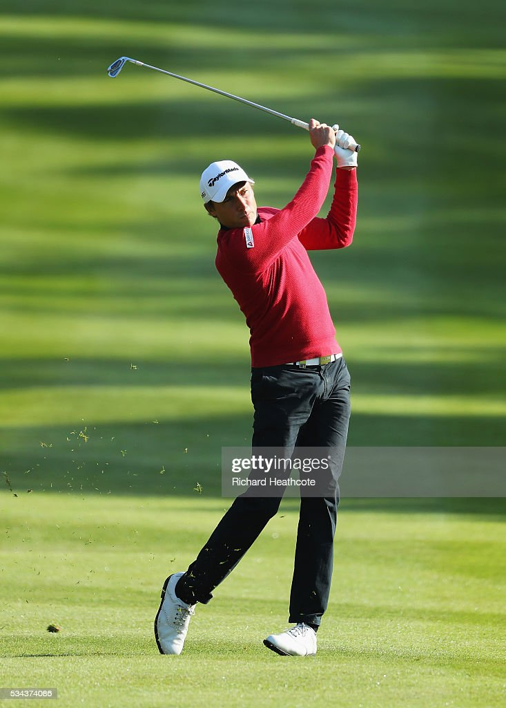 Benjamin Hebert of France hits his approach on the 4th hole during day one of the BMW PGA Championship at Wentworth on May 26, 2016 in Virginia Water, England.