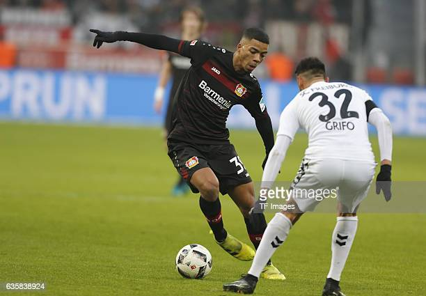 Benjamin Heinrichs of Leverkusen and Vincenzo Grifo of Freiburg battle for the ball during the Bundesliga match between Bayer 04 Leverkusen and SC...