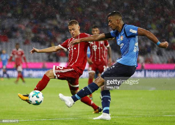 Benjamin Henrichs of Bayer Leverkusen with Joshua Kimmich of Bayern Muenchen during the Bundesliga match between FC Bayern Muenchen and Bayer 04...