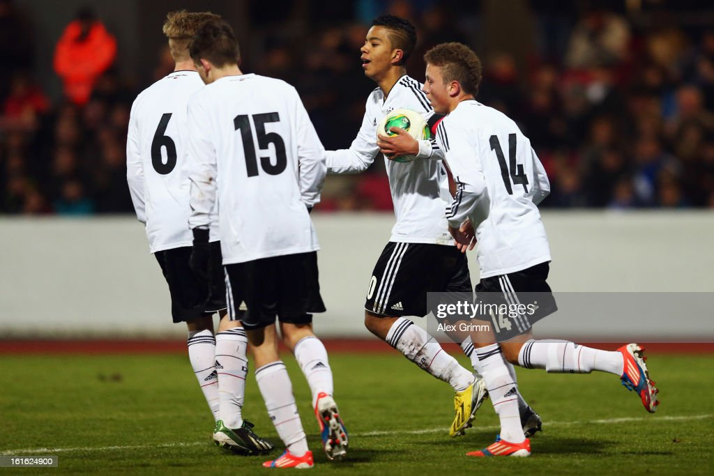 Benjamin Henrichs (2R) of Germany celebrates his team's fourth goal with team mates during the U16 international friendly match between Germany and England at Suedstadion on February 13, 2013 in Cologne, Germany.