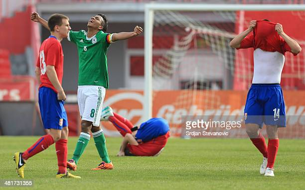 Benjamin Henrichs of Germany celebrates near Nikola Mitrovic and Mile Sarenac of Serbia after the UEFA Under17 Elite Round between Serbia and Germany...
