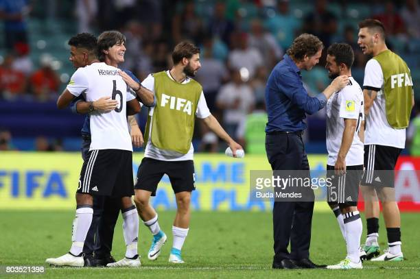 Benjamin Henrichs of Germany is congratulated by head coach Joachim Loew after the FIFA Confederations Cup Russia 2017 SemiFinal between Germany and...