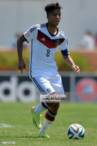 Benjamin Henrichs of Germany runs with the ball during the UEFA Under17 European Championship 2014 group B match between Germany and Switzerland at...