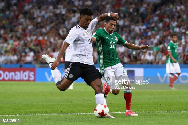 Benjamin Henrichs of Germany shoots while under pressure from Javier Aquino of Mexico during the FIFA Confederations Cup Russia 2017 SemiFinal...
