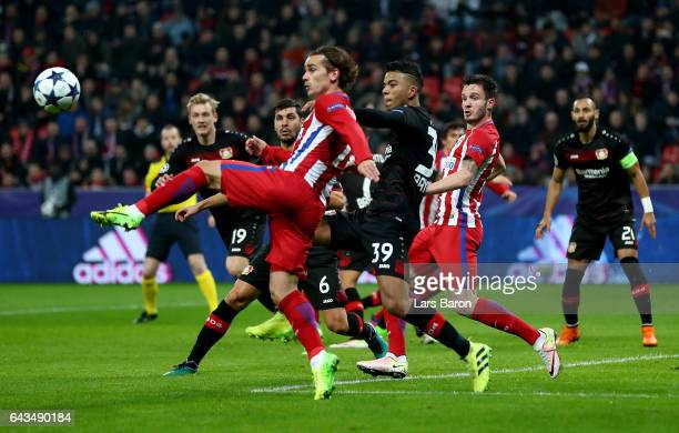 Benjamin Henrichs of Leverkusen and Antoine Griezmann of Atletico battle for the ball during the UEFA Champions League Round of 16 first leg match...