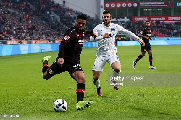 Benjamin Henrichs of Leverkusen and Marvin Plattenhardt of Berlin fight for the ball during the Bundesliga match between Bayer 04 Leverkusen and...