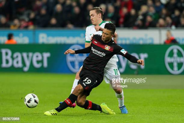Benjamin Henrichs of Leverkusen and Max Kruse of Werder Bremen battle for the ball during the Bundesliga soccer match between Bayer Leverkusen and...