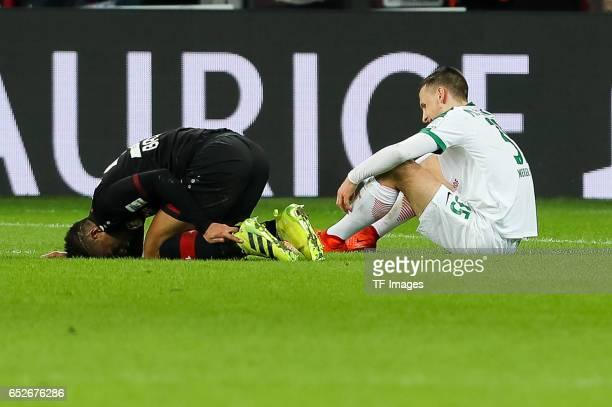 Benjamin Henrichs of Leverkusen and Maximilian Eggestein of Werder Bremen on the ground during the Bundesliga soccer match between Bayer Leverkusen...