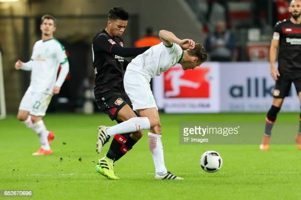 Benjamin Henrichs of Leverkusen and Robert Bauer of Werder Bremen battle for the ball during the Bundesliga soccer match between Bayer Leverkusen and...