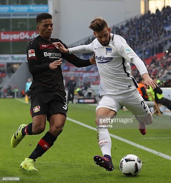 Benjamin Henrichs of Leverkusen is challenged by Marvin Plattenhardt of Berlin during the Bundesliga match between Bayer 04 Leverkusen and Hertha BSC...
