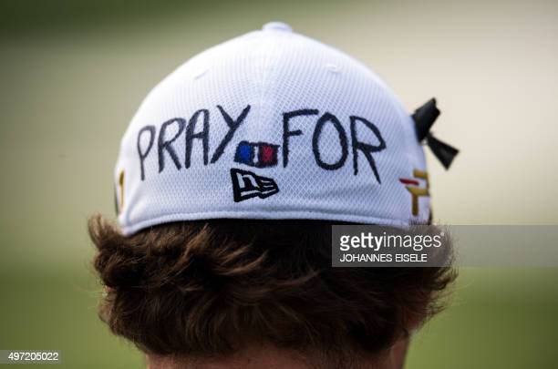 Benjamin Herbert of France wears a cap with reading 'pray for Paris' to commemorate the victims of the Paris attacks during the BMW Shanghai Masters...