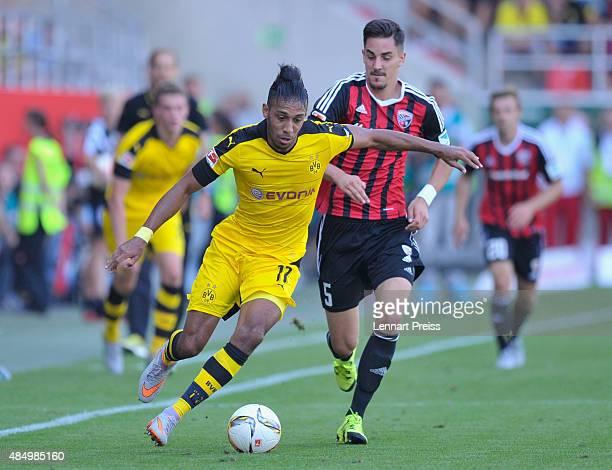 Benjamin Huebner of FC Ingolstadt challenges PierreEmerick Aubameyang of Borussia Dortmund during the Bundesliga match between FC Ingolstadt and...