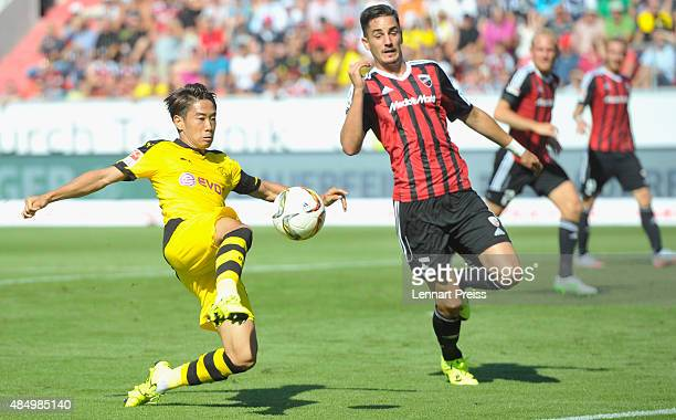 Benjamin Huebner of FC Ingolstadt challenges Shinji Kagawa of Borussia Dortmund during the Bundesliga match between FC Ingolstadt and Borussia...