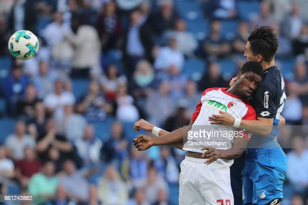 Benjamin Huebner of Hoffenheim about to score a header goal against Kevin Danso of Augsburg to make it 10 during the Bundesliga match between TSG...