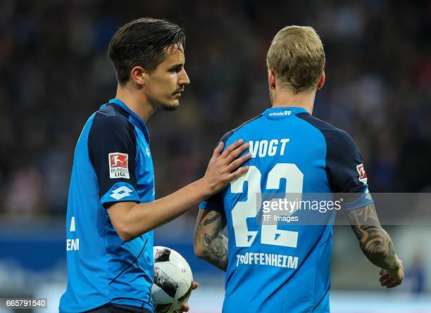 Benjamin Huebner of Hoffenheim and Kevin Vogt of Hoffenheim looks on during the Bundesliga match between TSG 1899 Hoffenheim and Bayern Muenchen at...