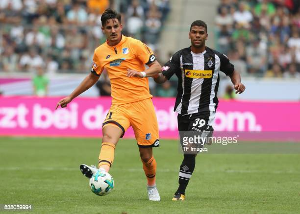 Benjamin Huebner of Hoffenheim and Kwame Yeboah of Moenchengladbach battle for the ball during the Telekom Cup 2017 3rd place match between Borussia...