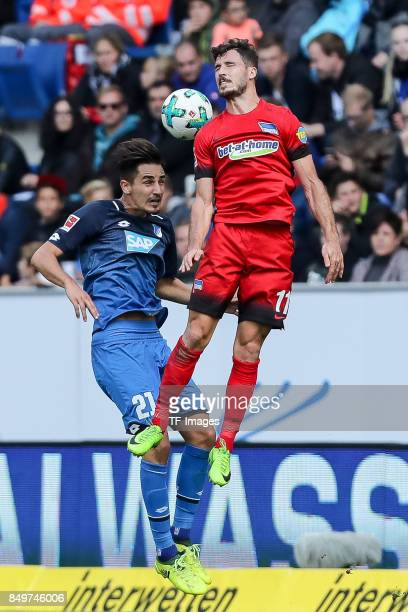 Benjamin Huebner of Hoffenheim and Mathew Allan Leckie of Berlin <battle for the ball during the Bundesliga match between TSG 1899 Hoffenheim and...