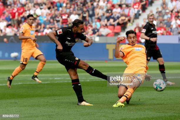 Benjamin Huebner Of Hoffenheim blocks a shot of Karim Bellarabi of Leverkusen during the Bundesliga match between Bayer 04 Leverkusen and TSG 1899...