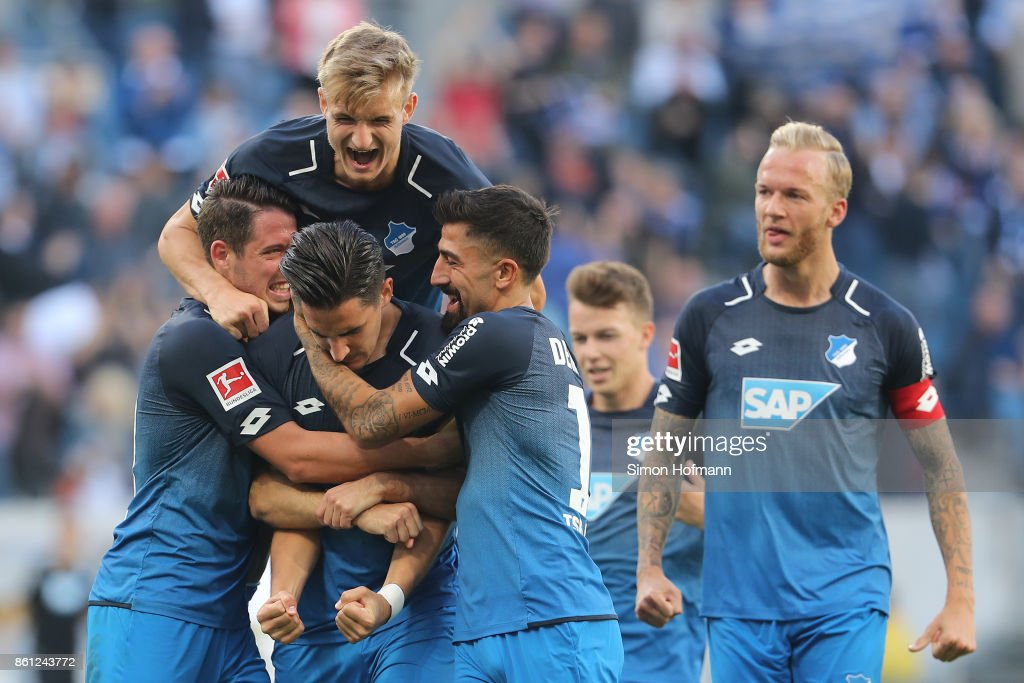 Benjamin Huebner of Hoffenheim (21) celebrates after he scored his teams first goal to make it 1:0 during the Bundesliga match between TSG 1899 Hoffenheim and FC Augsburg at Wirsol Rhein-Neckar-Arena on October 14, 2017 in Sinsheim, Germany.