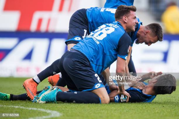 Benjamin Huebner of Hoffenheim celebrates his team's first goal with his team mates during the Bundesliga match between TSG 1899 Hoffenheim and...