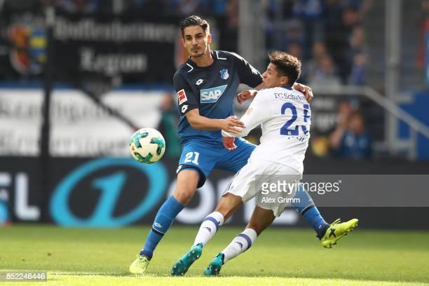 Benjamin Huebner of Hoffenheim fights for the ball with Amine Harit of Schalke during the Bundesliga match between TSG 1899 Hoffenheim and FC Schalke...