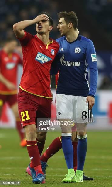 Benjamin Huebner of Hoffenheim reacts to Leon Goretzka of Schalke during the Bundesliga match between FC Schalke 04 and TSG 1899 Hoffenheim at...