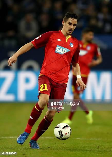 Benjamin Huebner of Hoffenheim runs with the ball during the Bundesliga match between FC Schalke 04 and TSG 1899 Hoffenheim at VeltinsArena on...
