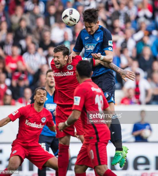 Benjamin Huebner of Hoffenheim scores his team's first goal against Marco Russ of Frankfurt during the Bundesliga match between TSG 1899 Hoffenheim...