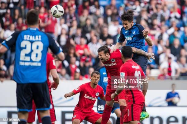 Benjamin Huebner of Hoffenheim scores his team's first goal against Marco Russ of Frankfurt during the Bundesliga match between TSG 1899 Hoffenheim...