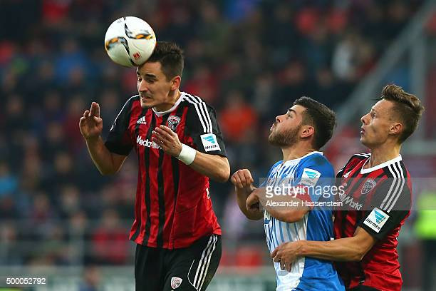Benjamin Huebner of Ingolstadt and his team mate Robert Bauer battles for the ball with Kevin Volland of Hoffenheim during the Bundesliga match...