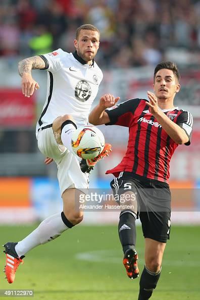 Benjamin Huebner of Ingolstadt battles for the ball with Luc Castaignos of Frankfurt during the Bundesliga match between FC Ingolstadt and Eintracht...