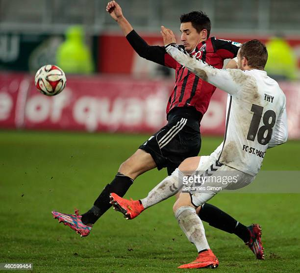 Benjamin Huebner of Ingolstadt fights for the ball with Lennart Thy of St Pauli during the Second Bundesliga match between FC Ingolstadt and 1 FC St...