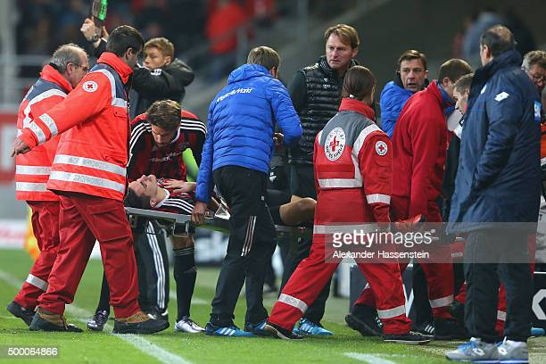 Benjamin Huebner of Ingolstadt is carried on a stretcher after getting injured during the Bundesliga match between FC Ingolstadt and TSG 1899...