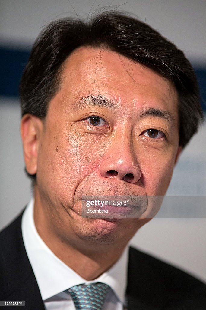 Benjamin Hung, chief executive officer for Hong Kong at Standard Chartered Plc, reacts during a news conference in Hong Kong, China, on Tuesday, Aug. 6, 2013. Standard Chartered, the U.K. bank that makes about three quarters of its earnings from Asia, posted a 24 percent drop in first-half profit after writing down the value of its Korean business by $1 billion. Photographer: Lam Yik Fei/Bloomberg via Getty Images