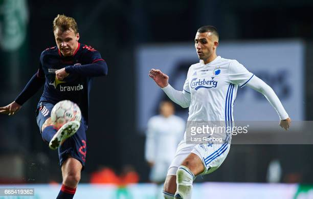 Benjamin Hvidt of AGF Aarhus and Youssef Toutouh of FC Copenhagen compete for the ball during the Danish cup DBU Pokalen quarterfinal match between...