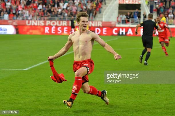 Benjamin Jeannot celebrates scoring during the Ligue 1 match between Dijon FCO and Paris Saint Germain at Stade Gaston Gerard on October 14 2017 in...